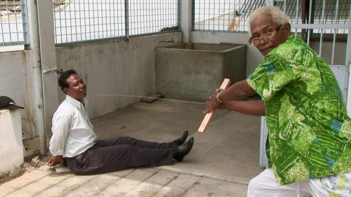 Actors reenacting a scene in film, 'The Act of Killing'