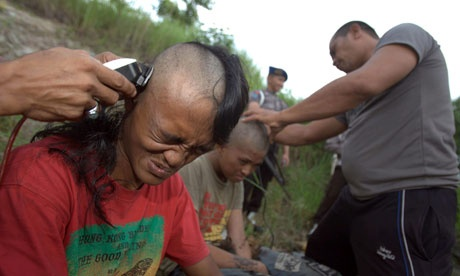 Indonesian police shave mohicans off punks who were seized at a concert. Photograph: Hotli Simanjuntak/EPA Avaliable at