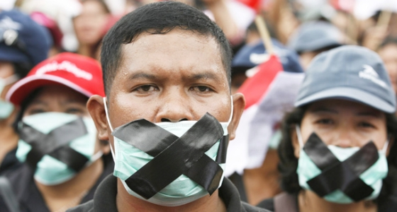 Protesters cover their mouths during a rally in Jakarta, demanding the president do more to protect their freedom of religion. (Dawn 2010)