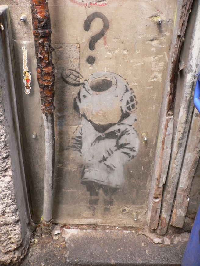 The 'Little Diver' by Banksy can be viewed in Cocker Alley, off Flinders Lane, Melbourne. The stencil has been protected by a clear perspex screen.