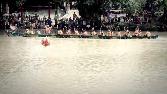 Participants of one of the dragon boats winning the race.