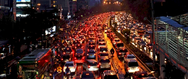 Vehicles are caught in a traffic jam in Jakarta
