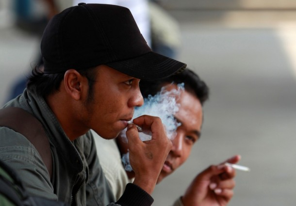 1.-Men-smoke-cigarettes-at-railway-station-in-Jakarta-May-e1347421162666