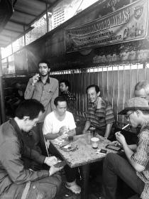 Men socialising at the Warkop Sarram