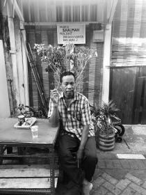 Local man enjoying a coffee and cigarette in a legislative smoke-free zone